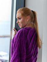 young beautiful woman in purple jersey