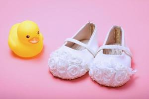 cute baby shoes for girl kids on pink background.