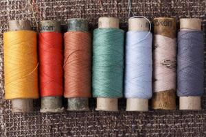 vintage bobbins with colorful threads