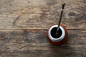 Tea mate on wooden background
