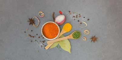 Spices and herbs in metal bowls.