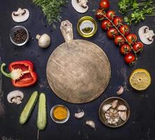 cutting board, around lie ingredients variety of vegetables fruitstop view