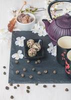 Asian tea set with dried green tea and sugar photo