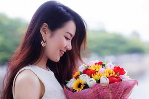 Asia young cute woman smelling  flowers