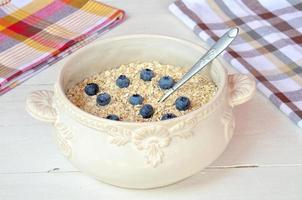 Bowl of fine oat flakes with fresh fruit photo