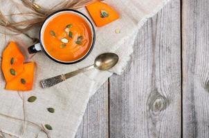 Fresh orange pumpkin soup in a mug