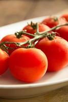 Cherry tomatoes in a dish photo
