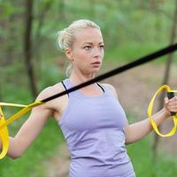 Training with fitness straps outdoors. photo