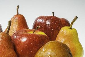 Set of wet apples and wet pears