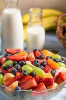 Preparing a healthy fruit salad photo