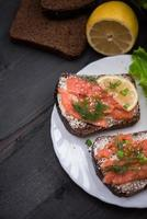 Sandwich with salmon for breakfast photo