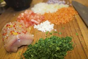 Seasoned fresh sea trout, and ingredients for sauce