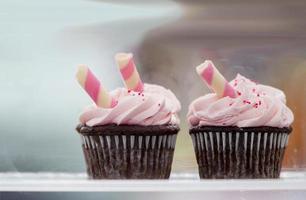 Chocolate cupcakes, pink icing