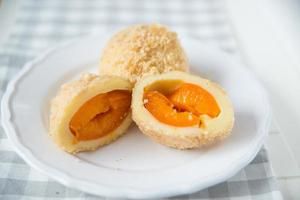 Sweet potato dumplings filled with apricots