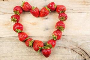Strawberries positioned in a heart shape. photo