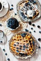 Waffles and blueberries on the table