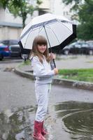 girl under white umbrella