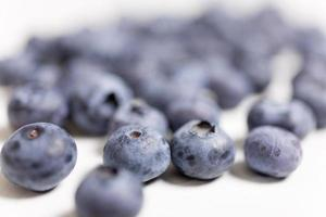 fresh blueberries on light wood