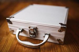 Metal Briefcase on wood table photo
