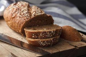 Dark multigrain bread whole grain fresh baked on rustic slices photo