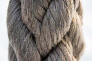 Gray nautical rope, closeup background texture photo