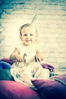Little princess with old gold toy