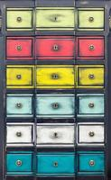 Cupboard with multicolored drawers photo
