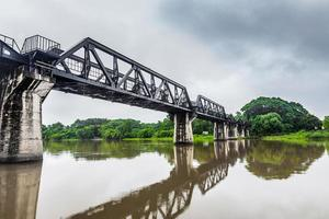 Railway Bridge in the rain cloud, River Kwai, Kanchanaburi, Thailand photo