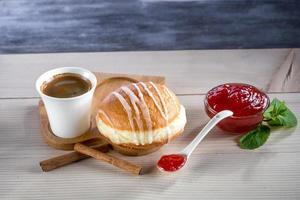 Donut with jam and coffee