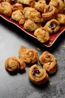 Sweet puf pastry appetizer with fruity marmalade photo