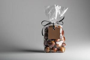 Bag of chestnuts with brown blank label and copy space