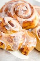 Freshly baked cinnamon rolls with icing drizzled over