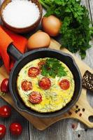Scrambled eggs with tomatoes photo