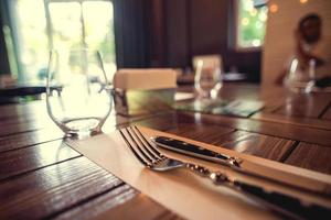 Knife and fork set on a wooden vintage table. Selective