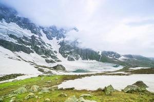 Frozen lake with mountain photo