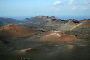 Volcanic landscape, Timanfaya National Park, Lanzerote, Spain photo