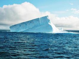 Sun shining on iceberg