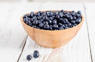 Wooden bowl with forest blueberry photo