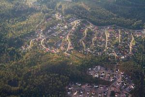 Small town surrounded by forest.