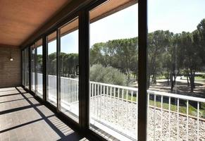 Glass terrace with a pine forest view