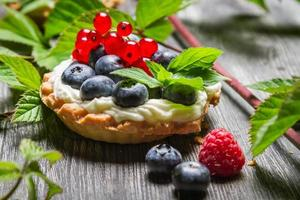 Forest cupcake with berry fruits
