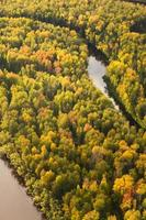 Top view of forest river in autumn photo