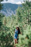 long hair woman travel in spruce forest photo