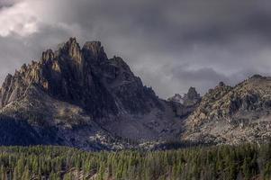 Braxon peak rises above the forest.