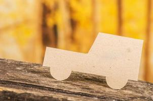 cut out paper car silhouette over forest background