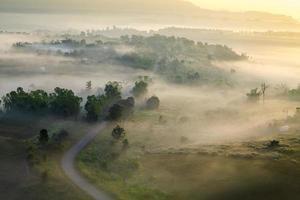 misty morning sunrise and road in mountain at Khao-kho Phetchabu