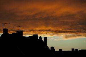 rooftops and orange clouds