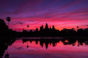 beautiful silhouette of Angkor Wat during sunrise