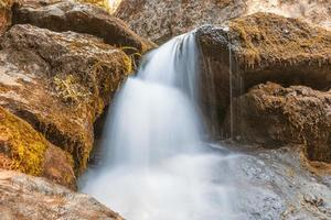 mountain river flowing among stones photo