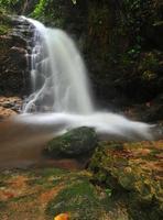 Waterfall spring season located in deep rain forest jungle. photo